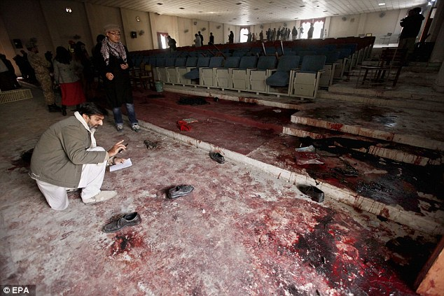 Nightmare scene: The pictures of the school's interior emerged as Pakistan began three days of mourning.