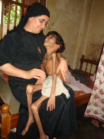 Sister Hatune holds a malnourished boy in India, one of the dozens of countries in which her foundation works.