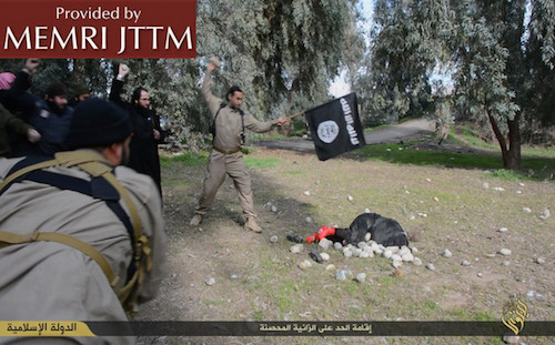 ISIS men stoning the woman to death