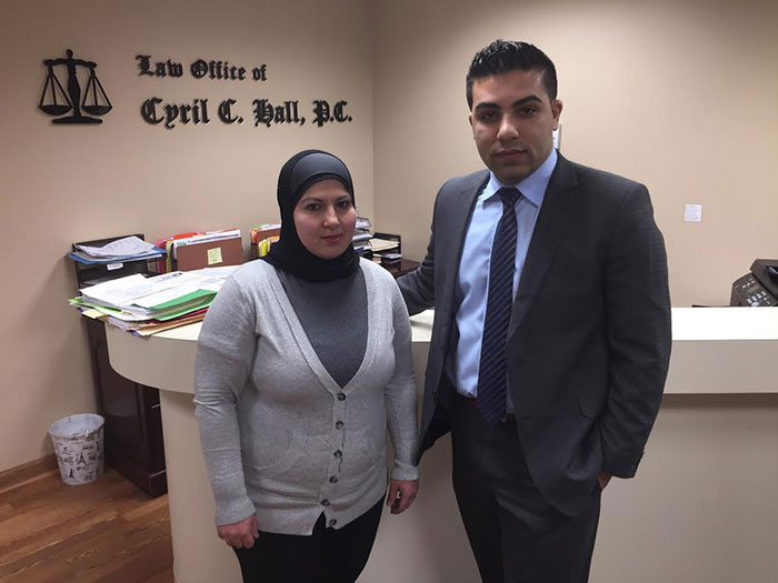 Malak Kazan (left), with Attorney Amir Makled, is filing a lawsuit against the city of Dearborn Heights for forcing her to remove her hijab.  Photo credit: Samer Hijazi