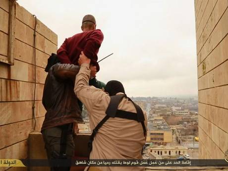 Isis images appear to show the execution of two men accused of being gay.