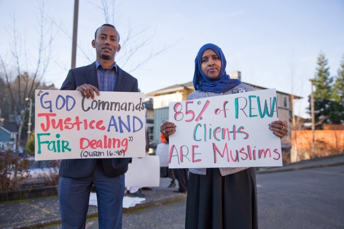 Hassan Diis (left) and Ubah Warsame at the latest in a series of demonstrations at ReWA Friday demanding a teacher be fired. More protests are planned for next week. (Photo by Alex Garland)