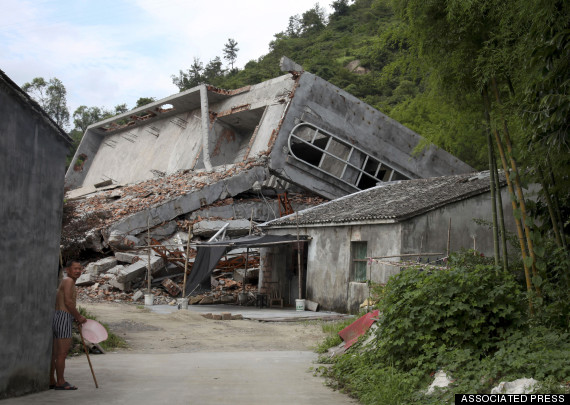 A villager stands next to a demolished Christian church outside the city of Wenzhou in Zhejiang province.