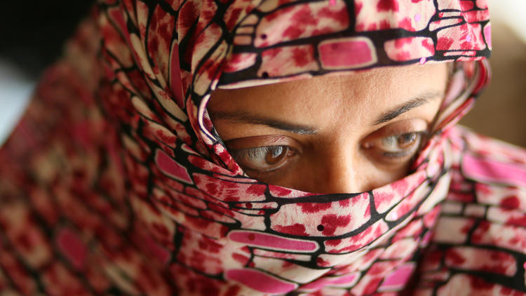 One of Mohammed Abdullah Saleem's accusers, a 45-year-old mother of two, claims he abused her as a minor in 1982. She covers her face to protect her identity. (Stacey Wescott, Chicago Tribune)