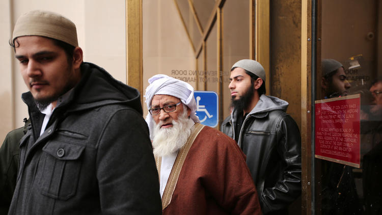 Flanked by supporters Mohammad Abdullah Saleem, the founder of the Islamic Institute of Education boarding school, leaves the Circuit Court of Cook County on Feb. 17. (Anthony Souffle / Chicago Tribune)