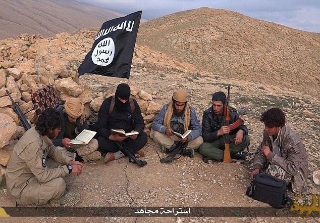 Taking it easy: The six holidaying jihadis are also seen sitting cross-legged in a semi-circle as they pose for photographs showing them reading the Koran while they relax in the Iraqi mountains.