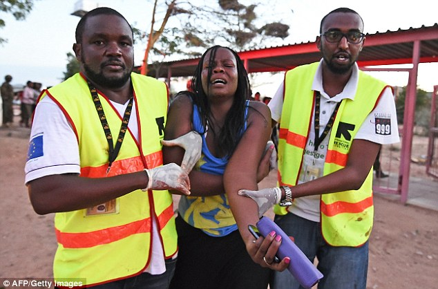 Paramedics help a woman who was injured during the attack on the Garissa University campus yesterday.