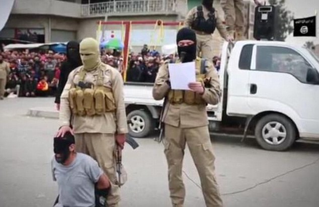 Sentenced to beheading: One of the four men is seen blindfolded and forced to his knees in central Mosul while a masked Islamic State militant reads out the charges against him.