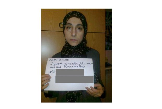 Zubeidat Tsarnaeva holds a sign in an image discovered by Vocativ on Russian social media platform VKontakte.