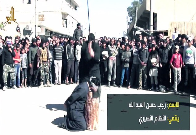 Gruesome: One by one, the alleged soldiers of Syrian President Bashar Al Assad's regime are marched to a wooden stump and killed in front of a large crowd of men and young boys (pictured).