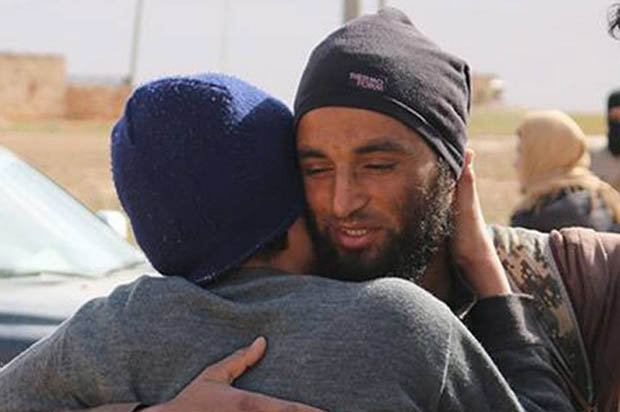 SICK: An Islamic State killer hugging one of the two gay men he later executed [NC]