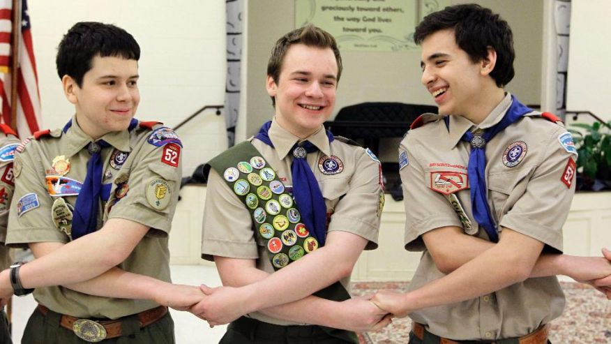 FILE - In this Monday, Feb. 10, 2014 file photo, Pascal Tessier, center, takes part in an activity with fellow scouts Matthew Huerta, left, and Michael Fine, right, after he received his Eagle Scout badge in Chevy Chase, Md. On Thursday, April 2, 2015, the Boy Scouts' New York chapter announced it hired Tessier as the nation's first openly gay Eagle Scout as a summer camp leader in public contrast to the national scouting organization's ban on openly gay adult members. (AP Photo/Luis M. Alvarez) (The Associated Press)