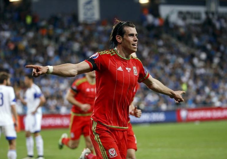 Wales' Gareth Bale celebrates scoring a goal against Israel during their Euro 2016 Group B qualifying soccer match at the Sammy Ofer Stadium in Haifa. (photo credit:REUTERS)