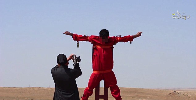 Islamic State militants have ratcheted up their savagery with a horrific video showing an executioner hacking off a prisoner's hand and foot while he is tied to a cross.
