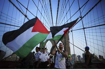 Anti-Israel protesters wave PLO flags in New York City. Reuters