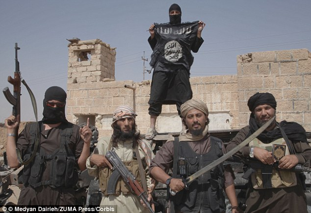Terror alert: Isis fighters, such as the ones pictured here in Syria, have allegedly inspired at least 30 Americans who have been arrested by the FBI.