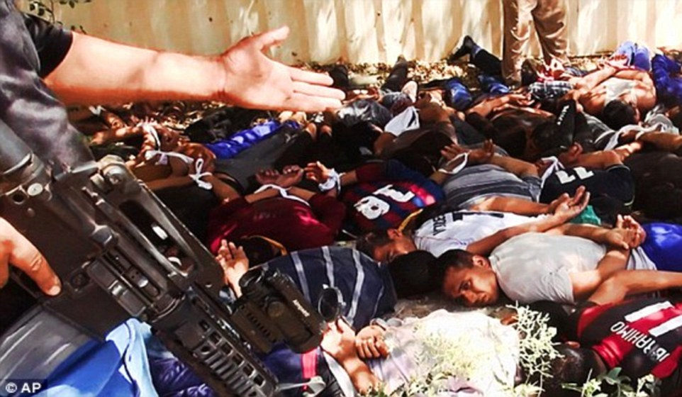 Gruesome: Hundreds of Iraqi soldiers were rounded up by ISIS militants in Saddam Hussein's hometown of Tikrit in June 2014 (pictured), before they were shot dead in bloody mass executions.