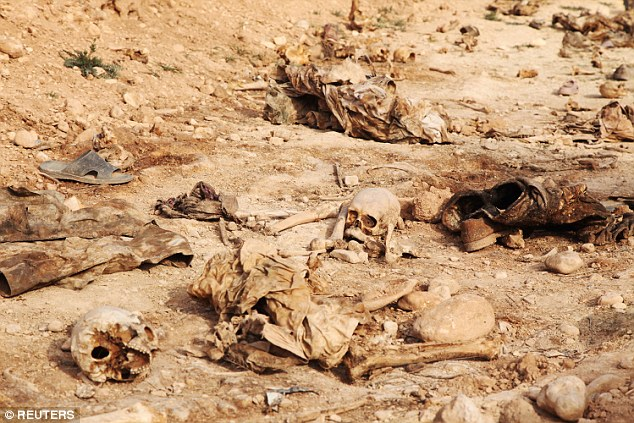 Death: Human skulls were found in a mass grave on the outskirts of the town of Sinjar where police said the grave contained remains from 25 people belonging to the minority Yazidi sect, killed by Islamic State militants.
