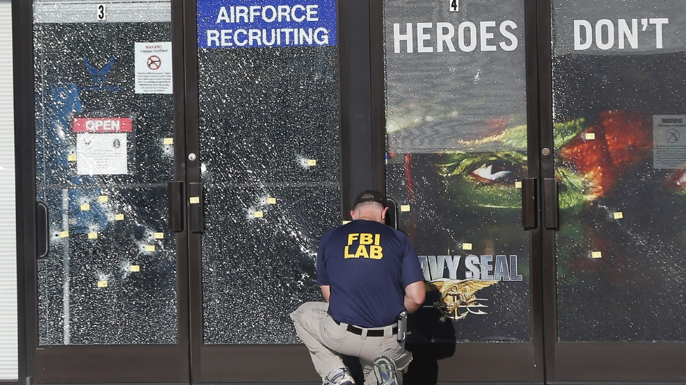 An FBI investigator works the scene of the July 16 shooting rampage in Chattanooga, Tenn.
