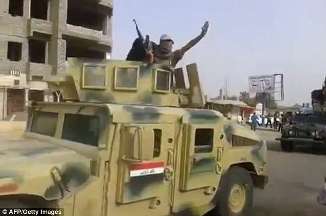 Sickening: A depraved Islamic State militant used an 11-year-old sex slave as a human shield by strapping her to the bonnet of a military Humvee (like the one above) while driving into battle.