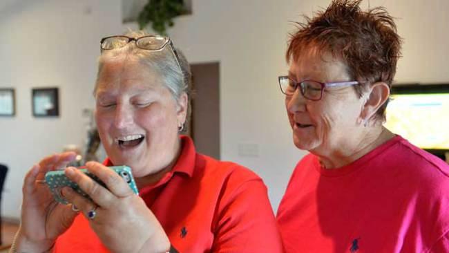 April Miller, left, and Karen Roberts react to the news.