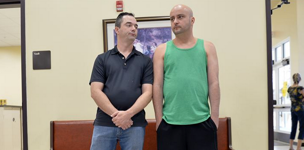 James Yates, left, and William Smith Jr. wait in line at the Rowan County Clerks Office to obtain a marriage license in Morehead, Ky., on Thursday.