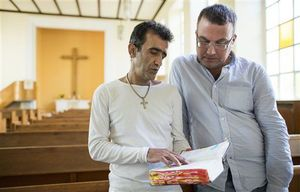 Iranian asylum-seekers Aref Movasaq Rodsari, left, and Vesam Heydari stand in the Trinity Church in Berlin, Germany.