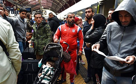 Refugees arrive at Copenhagen Central Station on Thursday.