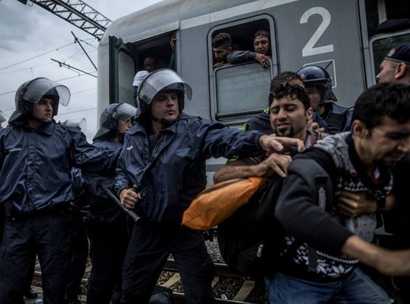 Croatian police trying to move migrants away from a train this week
