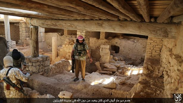 ISIS jihadists prepare to destroy the ancient Syriac Catholic monastry of Mar Elian in the central Syrian town of Al-Qaryatain
