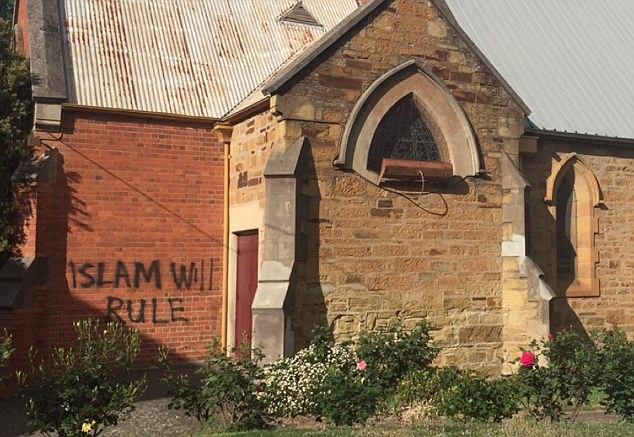Graffiti saying 'Islam will rule' mars the side of historic All Saints Anglican Church in Bendigo, Australia, just minutes away from where 1,000 protesters started an anti-Mosque rally.