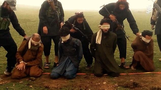ISIS gunmen prepare to execute prisoners in August.