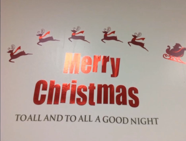 "The ""Merry Christmas"" message before the red words were removed"