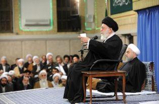 With President Hasan Rouhani seated behind him, supreme leader Ayatollah Ali Khamenei speaks on Tuesday.