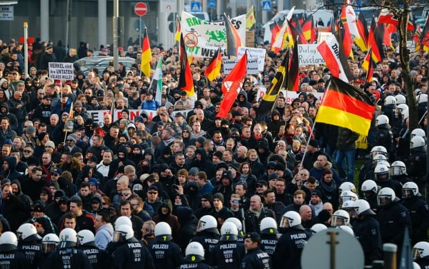 "A German police spokeswoman said the anti-immigrant protest attracted some 1,700 people, half of whom she described as coming from the ""hooligan scene."""