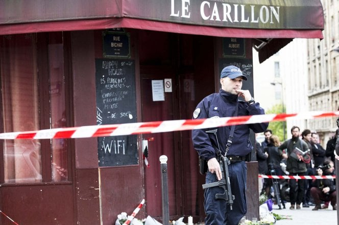 A police officer with a submachine gun stands guard after November's Islamist terror attacks in Paris.