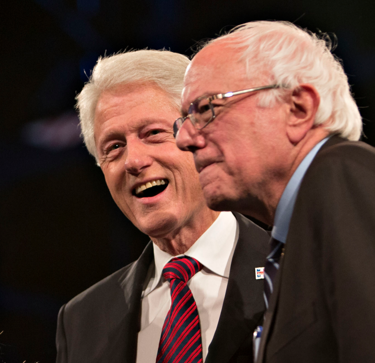 Bernie Sanders (left) and Bill Clinton (lefter) in happier times