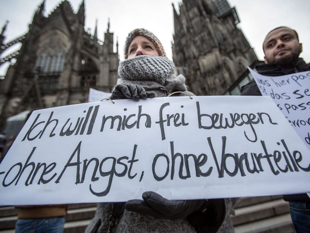 "The sign of a woman protesting sex assaults in Cologne, Germany reads: ""I want to move freely – without fear, without prejudices."" Better look at who is invading your continent."