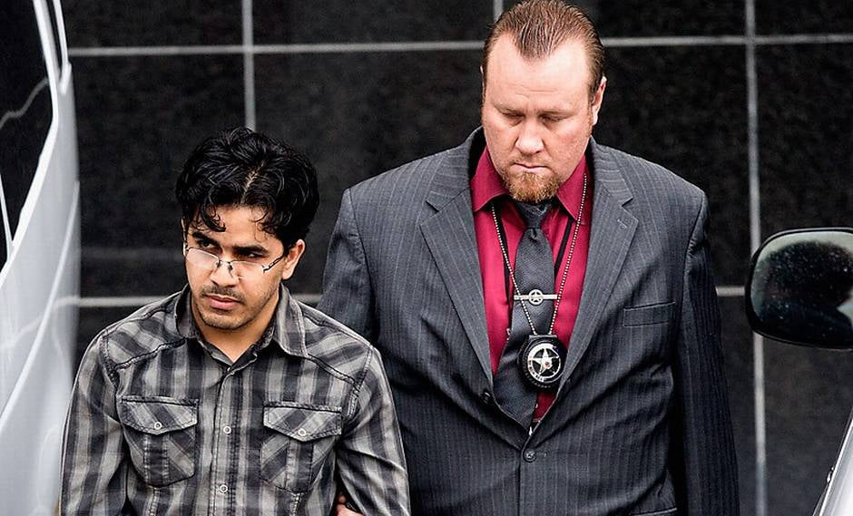 A U.S. marshal escorts Omar Faraj Saeed Al Hardan from the Bob Casey Federal Courthouse on Jan. 8 in Houston.