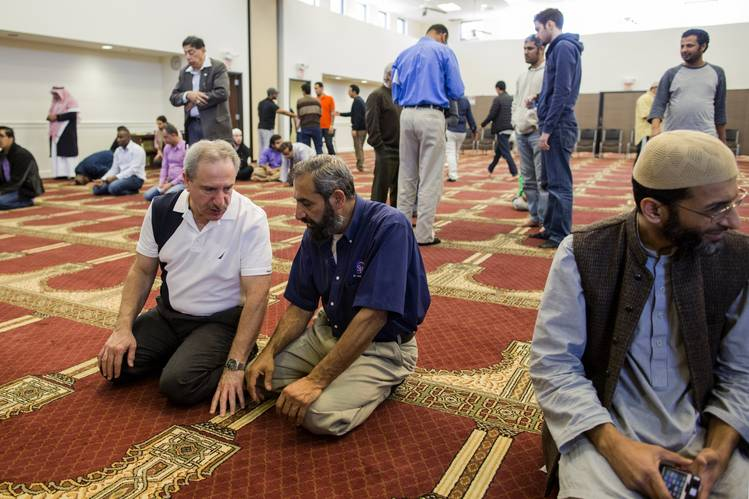 Saleh Sbenaty, at left, shown after Friday prayers last October at the Islamic Center in Murfreesboro, Tenn., says the textbook lessons on Islam are 'just teaching our kids history.'