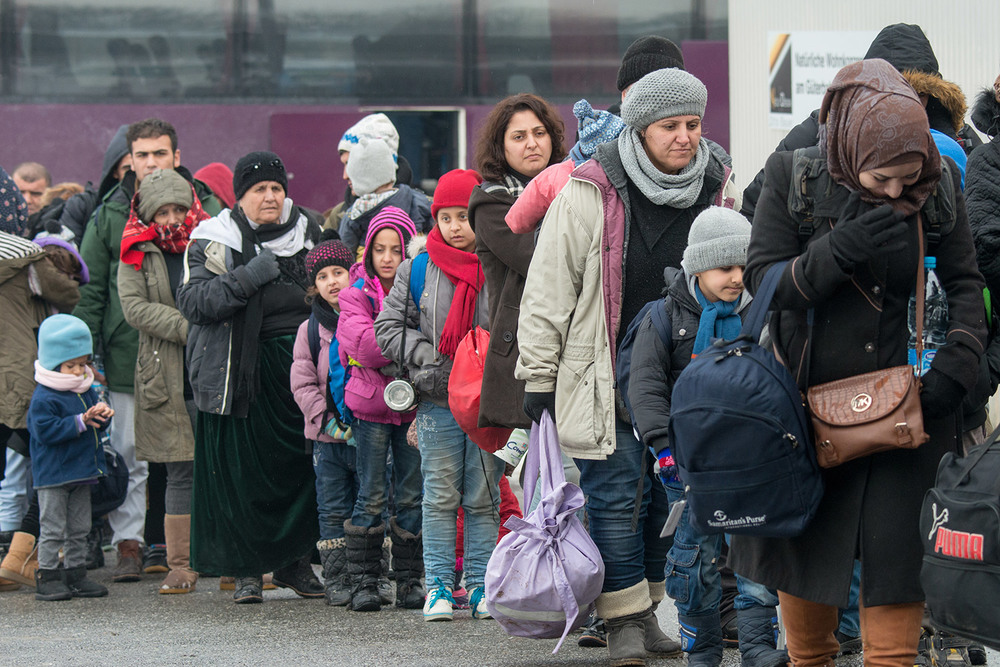 Syrian migrants wait in line in Germany.