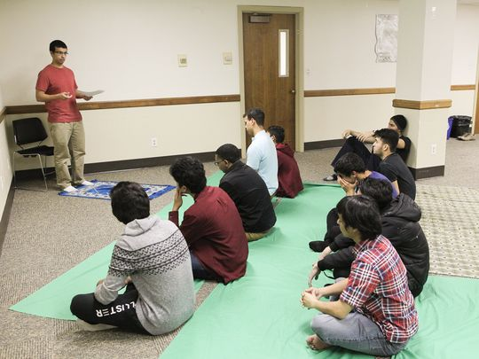 Mohammed Ismail leads a prayer service with the University of Iowa Muslim Student Association in the Lucas Dodge Room at Iowa Memorial Union late last year.