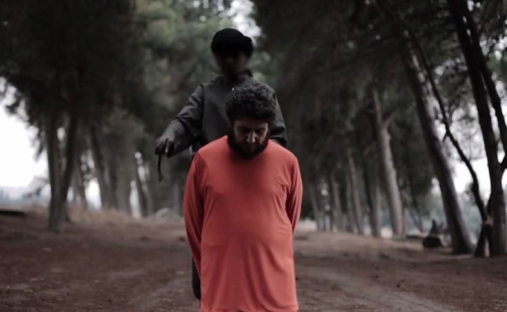 The young boy wields a knife as his victim kneels down.