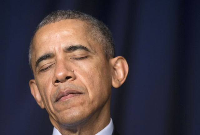 President Obama closes his eyes while a prayer is made at the National Prayer Breakfast in Washington on Thursday.