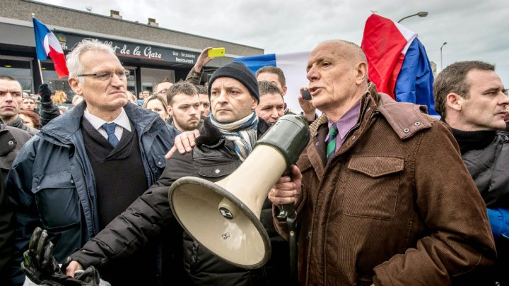 Retired General Christian Piquemal addresses protesters at a banned anti-migrant rally in Calais on Feb. 6.