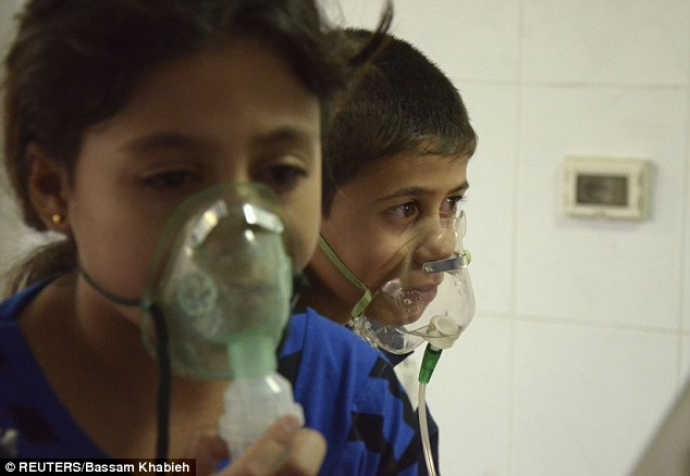 Hundreds of people required treatment, including these children, following a suspected poison gas attack on the rebel-held Damascus suburb of Saqba in August 2013.