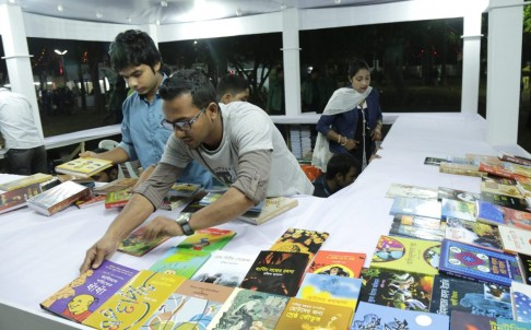 A sales representative displays books in a stall during the Ekushey Book Fair organised by the Bangla Academy in Dhaka, Bangladesh.