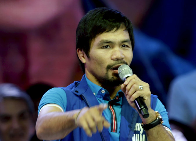 Manny Pacquiao, 37, is a born-again Christian and second-term congressman in the Philippines.