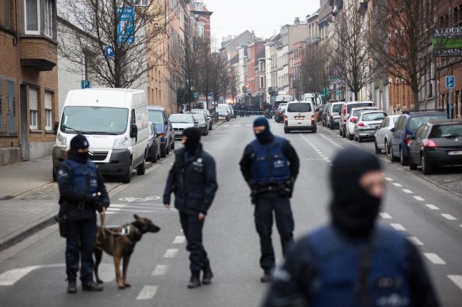Belgian police patrol the streets of Molenbeek after the arrest of Salah Abdeslam, a suspect in the Paris terror attacks.
