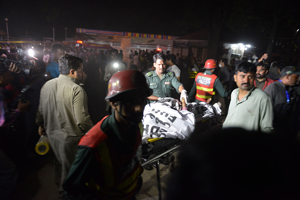 Pakistani rescuers use a stretcher to shift a body from a bomb blast site in Lahore on March 27.